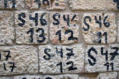 numbering: Wall of an old historic house after restoration Stock Photo