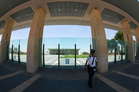 knesset: JERUSALEM, ISRAEL - JULY 06, 2014: Guard at the entrance to the Knesset, Jerusalem