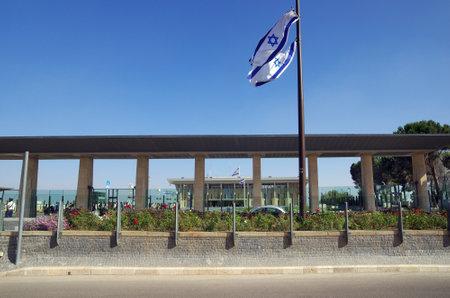 knesset: JERUSALEM, ISRAEL - JULY 06, 2014: Entrance to the Knesset, decorated with the national flag, Jerusalem