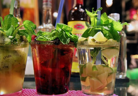 alcoholic drinks: Fruit alcoholic drinks with pieces of fruit in a bar Stock Photo