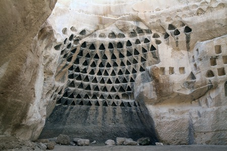 bird of israel: Columbarium - the ancient dovecote in the natural cave, Israel Stock Photo