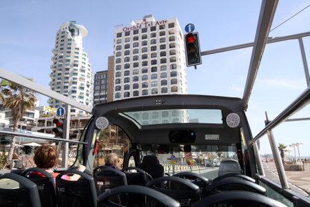 tel: TEL AVIV, ISRAEL - MAY 19, 2014: Sightseeing bus on the promenade in Tel Aviv