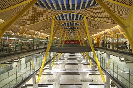 barajas: MADRID, SPAIN - OCTOBER 10, 2013: Modern interior in Barajas Airport, Madrid