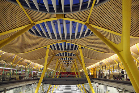 barajas: MADRID, SPAIN - OCTOBER 10, 2013: Modern interior in Barajas Airport, Madrid