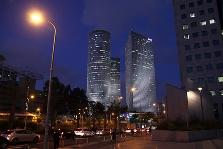 aviv: TEL AVIV, ISRAEL - MAY 10, 2015: Azrieli skyscrapers in Tel Aviv in evening
