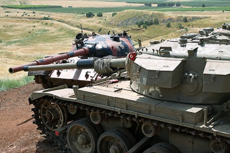 yom kippur: GOLAN HEIGHTS, ISRAEL - MAY 27, 2015: Syrian tank T-55 and Israeli tank Centurion. Tank Memorial Valley of Tears, after the Yom Kippur War of 1973, Golan Heights Editorial