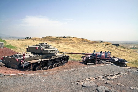 syrian war: GOLAN HEIGHTS, ISRAEL - MAY 27, 2015: Syrian tank T-55 and Israeli tank Centurion. Tank Memorial Valley of Tears, after the Yom Kippur War of 1973, Golan Heights Editorial