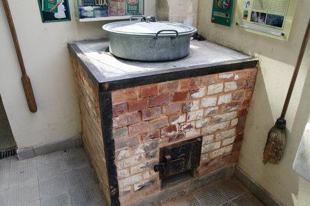 washboard: TEL AVIV, ISRAEL - MAY 10, 2015: Former laundry, brick oven and a basin with washboard in Sarona