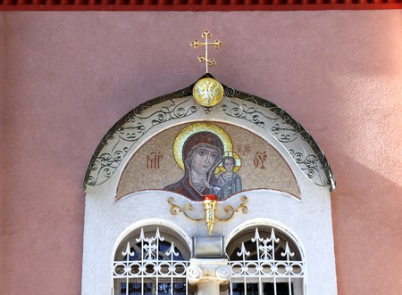 doubleheaded: Window with mosaic, the Russian double-headed eagle and an Orthodox cross. Church of St. Peter and righteous Tabitha, Jaffa, Israel