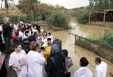 baptism: JORDAN RIVER, ISRAEL - DECEMBER 14, 2014: The baptism in the Jordan River for the Orthodox tradition Editorial