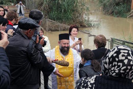 baptismal: JORDAN RIVER, ISRAEL - DECEMBER 14, 2014: The baptism in the Jordan River for the Orthodox tradition Editorial