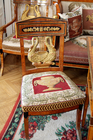 antique chair: TARKHANY, RUSSIA - AUGUST 19, 2012: Antique chair in the living room manor house in the family estate of Lermontov Tarkhany, Penza region