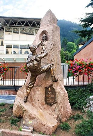 alpinist: TRENTINO, ITALY - OCTOBER 12: Monument climber set in the mountain resort of Trentino, Italy