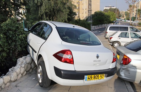 struck: BEER SHEVA, ISRAEL - NOVEMBER 27, 2011:  Car mistakenly drove onto the sidewalk and struck the fence