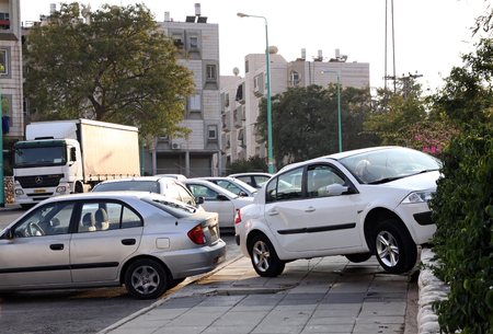 drove: BEER SHEVA, ISRAEL - NOVEMBER 27, 2011:  Car mistakenly drove onto the sidewalk and struck the fence