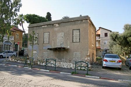 haifa: HAIFA, ISRAEL - DECEMBER 22, 2015: Abandoned and immured  house in Haifa Editorial