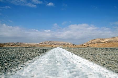 negev: Straight road leads through the Negev  desert Stock Photo