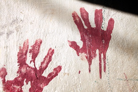 scene of a crime: Bloody palm prints at the crime scene Stock Photo