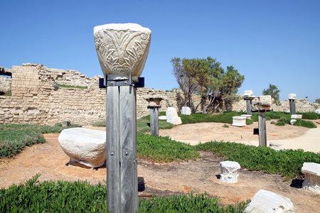 caesarea: CAESAREA, ISRAEL - FEBRUAR 28, 2016:  Capitals of ancient columns in the National Archaeological Park Caesarea Editorial