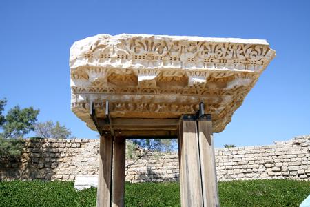 caesarea: CAESAREA, ISRAEL - FEBRUAR 28, 2016:  Fragment of the ancient cornice in the National Archaeological Park Caesarea