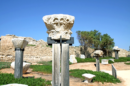 corinthian: CAESAREA, ISRAEL - FEBRUAR 28, 2016:  Capitals of ancient Corinthian columns in the National Archaeological Park Caesarea Editorial