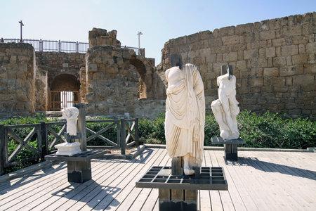 caesarea: CAESAREA, ISRAEL - FEBRUAR 28, 2016:  Fragments of marble sculptures  in Caesarea in the National Archaeological Park Caesarea
