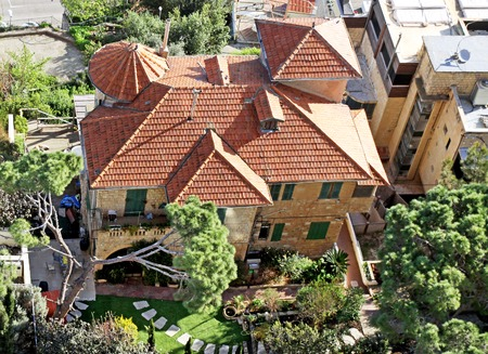 turrets: HAIFA, ISRAEL - FEBRUAR 29, 2016: Top view of a house with turrets under a tiled roof