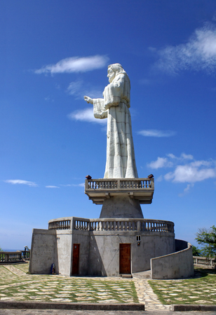 the stands: SAN JUAN DEL SUR, NICARAGUA - SEPTEMBER 21, 2015: Statue of Jesus Christ stands on a observation point above the San Juan del Sur in Nicaragua
