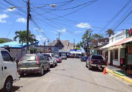 electric wires: SAN JUAN DEL SUR, NICARAGUA - SEPTEMBER 21, 2015: Randomly electric wires stretched over the street in San Juan del Sur