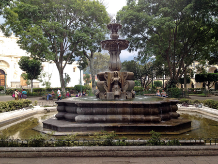 restoring: ANTIGUA, GUATEMALA - SEPTEMBER 30, 2015: Ancient fountain in the central square of Antigua Guatemalas former capital