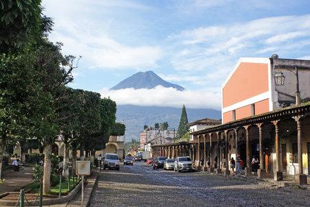 central square: ANTIGUA GUATEMALA - OCTOBER 02, 2015: Market in the central square of Antigua Guatemala, and the view of the volcano