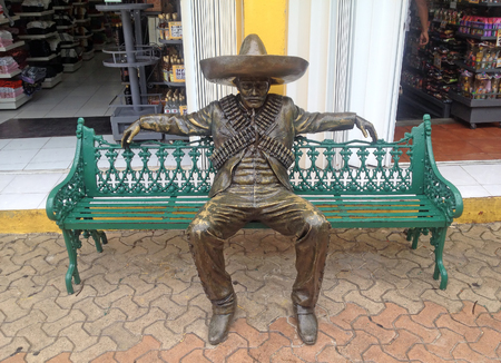 partisan: CANCUN, MEXICO - OCTOBER 19, 2015: Urban sculpture revolutionary national hero on the promenade in Cancun