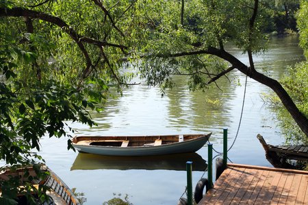 landing stage: Little landing stage and the boat in a small Russian River Stock Photo