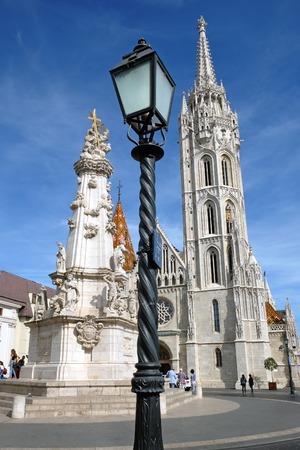 Lantern, Matthias Church and the Trinity  plague column in the Buda castle in Budapest