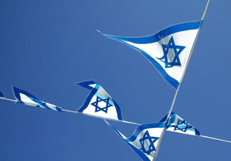 israeli: Pennants with Israeli symbols on the blue sky background