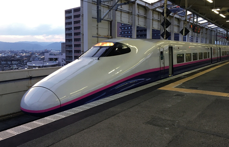 High-speed train is at the platform of the railway station of Fukushima