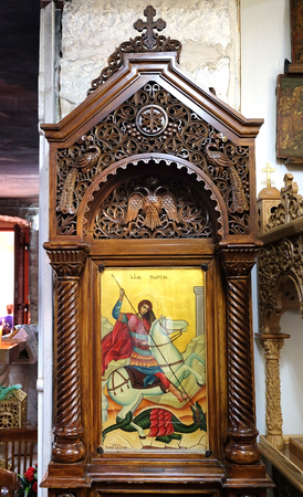 RAMLA, ISRAEL - JULY  22, 2017: Icon with the image of St. George the Victorious, defeating the dragon