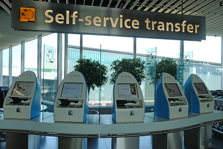 SCHIPHOL, HOLLAND - MAY 17, 2017: Racks for self-service transfer  at  the Amsterdam Schiphol airport