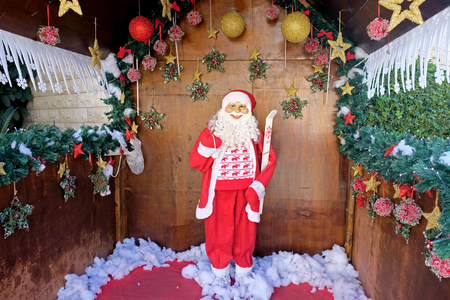 NAZARETH, ISRAEL - DECEMBER 15, 2018: Santa Claus in his house in the courtyard of the Greek Orthodox Church in Nazareth