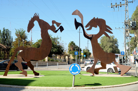 BEER SHEVA, ISRAEL - JANUAR 03, 2019: Modern sculptures of two stylized horses at a roundabout in the old town of Beer Sheva