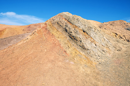 Colored sands in the Makhtesh Katan erosion crater in the desert in Israel