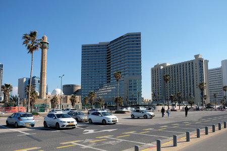 JAFFA, ISRAEL - FEBRUARY 23, 2019: Mosque, modern hotels and parking on the quay of Tel Aviv Sajtókép