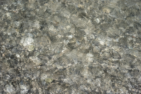 pepples: Surface of flowing water from above III Stock Photo