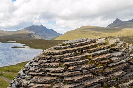 Upper part of The Globe by Joe Smith close to hiking trail at Knockan Crag in Northwest Highlands Geopark, Scotland