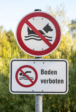 no swimming sign: German sign Baden verboten (translation: No swimming) for dogs and humans Stock Photo