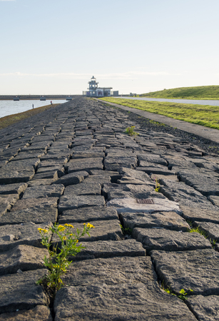 Dike and old lighthouse at Leith harbour, Edinburgh, Scotland Stock Photo
