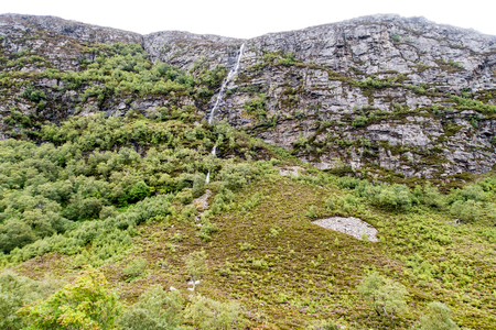 Slender waterfall at rock face near Little Loch Broom, Scottish Highlands, Northern Scotland