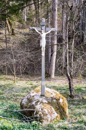 Wayside cross close to the Mangfallriver at the Mangfallknie, Germany, Bavaria