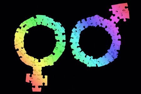 Rainbow Male and Female Signs made from puzzle pieces on black background
