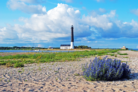 clody sky: Lighthouse Sorve on Saaremaa island in Estonia